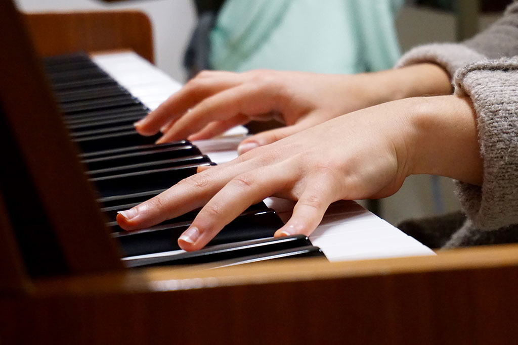 Image of child playing piano